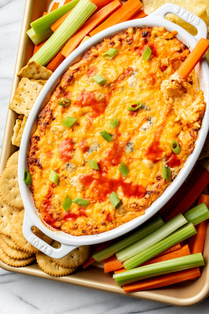 buffalo chicken dip surrounded by veggies, crackers, and chips
