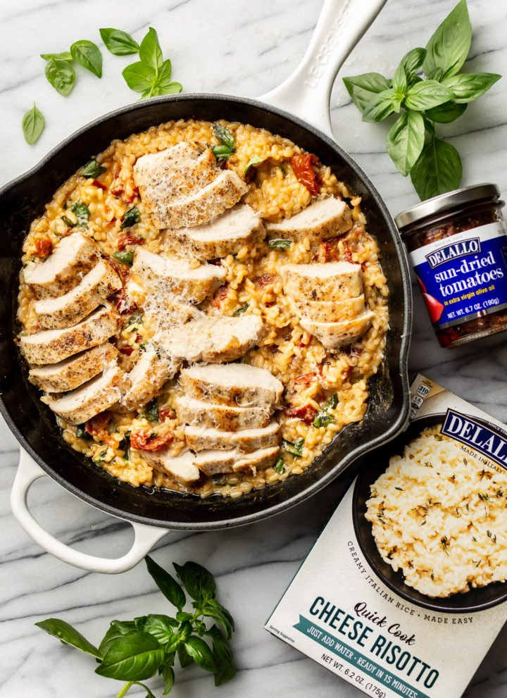 easy risotto skillet pictured with package of DeLallo's Quick Cook Risotto and jar of DeLallo sun-dried tomatoes