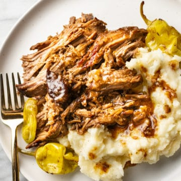 Mississippi pot roast on a plate with mashed potatoes