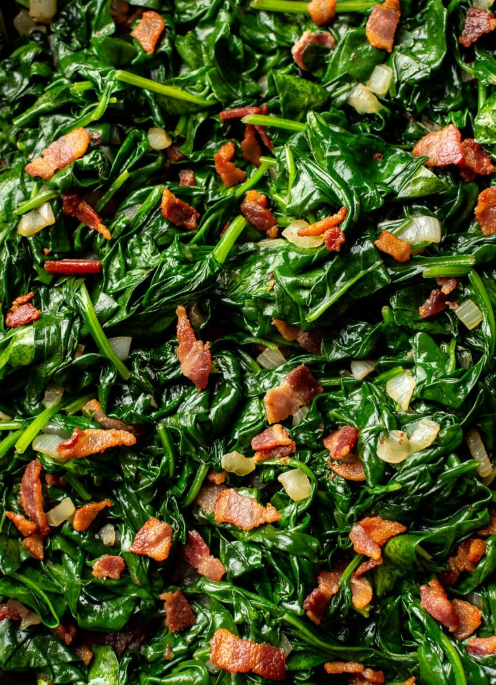 close-up of sautéed spinach with bacon