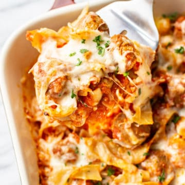 close-up of meatball casserole being lifted up by a spatula